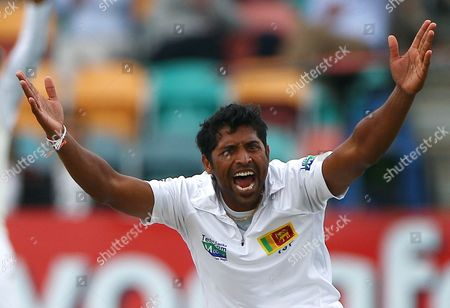 Sri Lanka's Chanaka Welegedara appeals for a LBW decision on Australia's Mike Hussey on the fourth day of their cricket test match at Bellerive Oval in Hobart, Australia, . Sri Lanka are all out for 336 in reply to Australia's 450-5 declared in their first innings