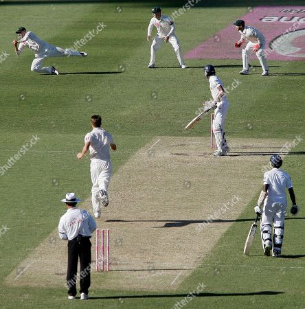 Sri Lanka's Suranga Lakmal, third right, is caught out by Australia's Mike Hussey, left, for 5 runs on the first day of their cricket test match in Sydney, Australia, . At stumps Sri Lanka are all out for 294 runs