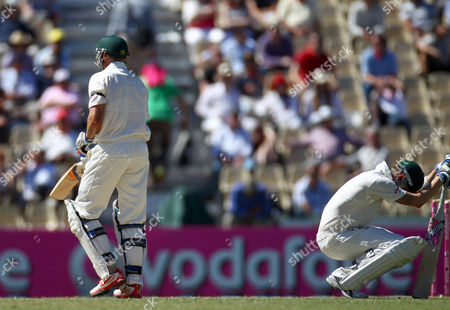 Australia's captain Michael Clarke, right, drops to his knees after teammate Mike Hussey, left, was run out for 25 runs against Sri Lanka on the second day of their cricket test match in Sydney, Australia, . Sri Lanka made 294 all out in their first innings