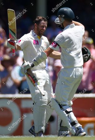 Australia's Matthew Wade, left, is congratulated by teammate Jackson Bird after making 100 runs against Sri Lanka on the third day of their cricket test match in Sydney, Australia, . Australia are declared 432 for 9 in reply to Sri Lanka's 294 all out in their first innings