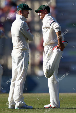 Stock Picture of Australia's captain Michael Clarke, left, talks with teammate Mike Hussey as he stretches before bowling the last over to Sri Lanka on the third day of their cricket test match in Sydney, Australia, . At stumps on day three Sri Lanka are 225 for 7 and have a 87 run lead
