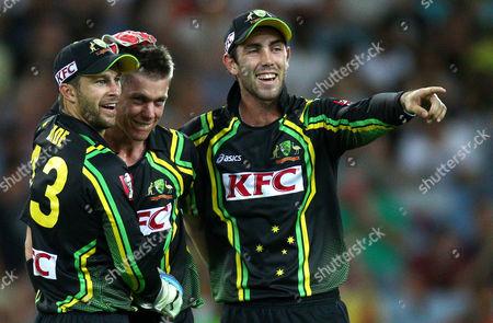 Australia's Matthew Wade, left, and Glenn Maxwell, right, congratulate Xavier Doherty after he bowled Sri Lanka's Mahela Jayawardene for 8 runs during their Twenty/20 international cricket match in Sydney, Australia, . Australia made 137 for 3 in their innings