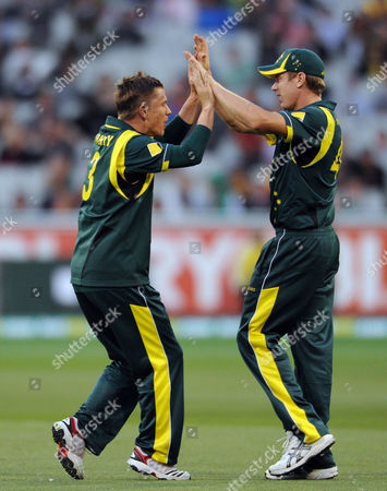 Australia's Xavier Doherty, left congratulates James Faulkner after capturing the wicket of Darren Bravo during their One Day International Cricket match against West Indies in Melbourne, Australia