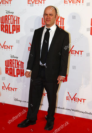 "Todd Barry American actor and comedian Todd Barry poses for photos as he arrives for a screening of the animated Disney feature, ""Wreck-It Ralph"" in Sydney"