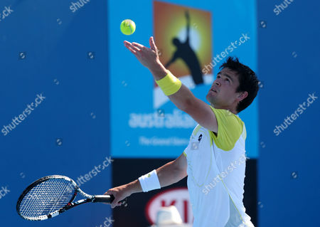 Stock Photo of Britain's Jamie Baker serves to Lukas Rosol of the Czech Republic during their first round match at the Australian Open tennis championship in Melbourne, Australia