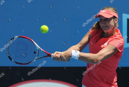 Russia's Ekaterina Makarova hits a backhand return to France's Stephanie Foretz Gacon during their second round match at the Australian Open tennis championship in Melbourne, Australia