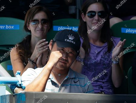 Jiang Shan, the husband of China's Li Na, reacts to a point as Li plays her semifinal match against Russia's Maria Sharapovaat the Australian Open tennis championship in Melbourne, Australia