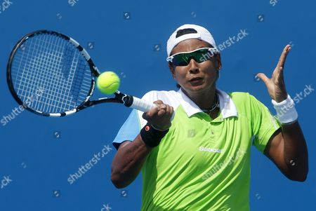 Stock Image of Akgul Amanmuradova of Uzbekistan hits a forehand return to Italy's Roberta Vinci during their second round match at the Australian Open tennis championship in Melbourne, Australia