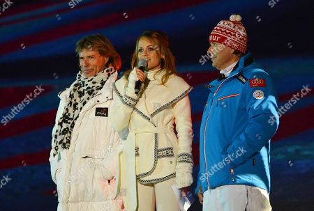 Singer Hansi Hinterseer, TV host Mirjam Weichselbraun and Peter Schroecksnadel, president of the Austrian skiing federation, from left, attend the opening ceremony at the Alpine skiing world championships in Schladming, Austria, Monday, Feb.4,2013