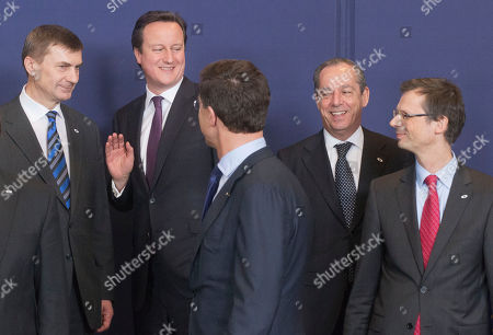 Uwe Corsepius, Andrus Ansip, David Cameron, Lawrence Gonzy, Mark Rutte From left, Estonia's Prime Minister Andrus Ansip, British Prime Minister David Cameron, Dutch Prime Minister Mark Rutte, Malta's Prime Minister Lawrence Gonzi and Secretary General of the Council Uwe Crsepius during a group photo at a EU Budget summit at the European Council building in Brussels, . European Union leaders drew hard lines Thursday ahead of a struggle over EU spending for the next seven years that reflects deep divisions about the role of their union