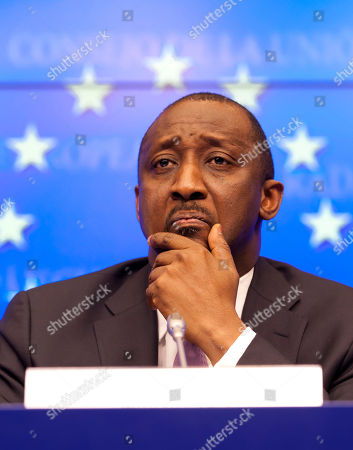 Tieman Coulibaly Mali's Foreign Minister Tieman Coulibaly pauses before answering a journalists question during a media conference after an emergency meeting of EU foreign ministers at the EU Council building in Brussels on . EU foreign ministers have approved sending a military training mission to the troubled African country of Mali, to shore up the Malian army and enable the country's government to regain control of all its territory