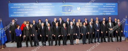 Catherine Ashton, Robert Fico, Jean-Claude Juncker, Mario Monti, Martin Schulz, Romania's President Traian Basescu, Cypriot President Dimitris Christofias, European Council President Herman Van Rompuy, Lithuania's President Dalia Grybauskaite, French Pres EU heads of state pose for the media, at the start of a two-day EU summit, at the European Council building in Brussels, . In one whirlwind morning, the European Union nations agreed on the foundation of a fully-fledged banking union and Greece's euro partners approved billions of euros in bailout loans that will prevent the nation from going bankrupt. First row from left to right: EU foreign policy chief Catherine Ashton, Slovakia's Prime Minister Robert Fico, Luxembourg's Prime Minister Jean-Claude Juncker, Italy's Prime Minister Mario Monti, European Parliament President Martin Schulz, Romania's President Traian Basescu, Cypriot President Dimitris Christofias, European Council President Herman Van Rompuy, Lithuania's President Dalia Grybauskaite, French President Francois Hollande, European Commission President Jose Manuel Barroso, Greek Prime Minister Antonis Samaras, Latvian Prime Minister Valdis Dombrovskis, Dutch Prime Minister Mark Rutte, and the Secretary-General of the EU Council Uwe Corsepius. Top row: Croatia's Prime Minister Zoran Milanovic, Denmark's Prime Minister Helle Thorning-Schmidt, Poland's Prime Minister Donald Tusk, Hungarian Prime Minister Viktor Orban, Belgium's Prime Minister Elio Di Rupo, Spain's Prime Minister Mariano Rajoy, Swedish Prime Minister Fredrik Reinfeldt, Czech Republic's Prime Minister Petr Necas, Slovenia's Prime Minister Janez Jansa, Portugal's Prime Minister Pedro Passos Coelho, German Chancellor Angela Merkel, Finland's Prime Minister Jyrki Katainen, Austrian Chancellor Werner Faymann, Bulgarian Prime Minister Boyko Borissov, Estonia's Prime Minister Andrus Ansip, British Prime Minister David Cameron, and Malta's Prime Minister Lawrence Gonzi