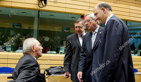 Pierre Moscovici, Wolfgang Schaeuble, Steven Vanackere, Jean-Claude Juncker German Finance Minister Wolfgang Schaeuble, left, speaks with from right, French Finance Minister Pierre Moscovici, Luxembourg's Prime Minister Jean-Claude Juncker and Belgium's Finance Minister Steven Vanackere during a meeting of eurogroup finance ministers in Brussels on . The European Union on Thursday took a major step towards one of the most important transfers of financial authority away from national capitals when its member states agreed to create a single supervisor for their banks