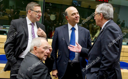 Pierre Moscovici, Wolfgang Schaeuble, Steven Vanackere, Jean-Claude Juncker German Finance Minister Wolfgang Schaeuble, second left, speaks with, from right, Luxembourg's Prime Minister Jean-Claude Juncker, French Finance Minister Pierre Moscovici and Belgium's Finance Minister Steven Vanackere during a meeting of eurogroup finance ministers in Brussels on . The European Union on Thursday took a major step towards one of the most important transfers of financial authority away from national capitals when its member states agreed to create a single supervisor for their banks