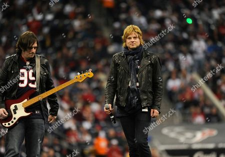 """Terry McDermott The Voice"""" finalist Terry McDermott, right, performs during halftime of an NFL wild card playoff football game between the Cincinnati Bengals and Houston Texans, in Houston"""