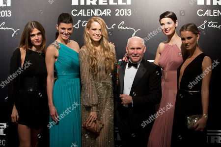 Elisa Sednaoui, Steve McCurry, Summer Rayne Oakes, Petra Nemcova, Kyleigh Kuhn, Hanaa Ben Abdesslem Photographer Steve McCurry poses with models, from left, Elisa Sednaoui, Summer Rayne Oakes, Petra Nemcova, Hanaa Ben Abdesslem and Kyleigh Kuhn at the 2013 Pirelli Calendar red carpet event in Rio de Janeiro, Brazil, . The calendar debuted in 1964 as a racy way of promoting Italian tire maker Pirelli and has since grown into a fashion institution. The 2013 calendar was shot entirely in Rio by celebrated American photojournalist Steve McCurry