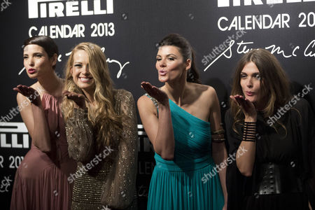 Hanaa Ben Abdesslem, Petra Nemcova, Summer Rayne Oakes, Elisa Sednaoui Models, from left, Hanaa Ben Abdesslem, Petra Nemcova, Summer Rayne Oakes and Elisa Sednaoui blow kisses as they pose for photos at the 2013 Pirelli Calendar red carpet event in Rio de Janeiro, Brazil, . The calendar debuted in 1964 as a racy way of promoting Italian tire maker Pirelli and has since grown into a fashion institution. The 2013 calendar was shot entirely in Rio by celebrated American photojournalist Steve McCurry