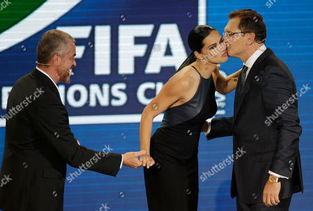 FIFA Secretary General Jerome Valcke, right, welcomes draw assistants Brazilian supermodel Adriana Lima and renowned chef Alex Atala, left, during the draw for the 2013 soccer Confederations Cup in Sao Paulo, Brazil, . The soccer Confederations Cup will be played June 15 through June 30 in six Brazilian cities