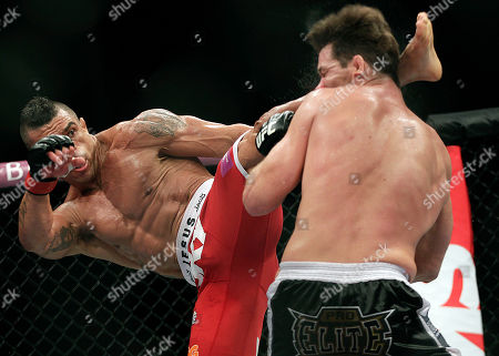 Vitor Belfort, from Brazil, left, kicks Michael Bisping, from Britain during their middleweight mixed martial arts bout at the Ultimate Fighting Championship (UFC) in Sao Paulo, Brazil