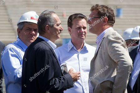 Jerome Valcke, Gilberto Kassab, Aldo Rebelo Brazil's Sports Minister Aldo Rebelo, second left, Sao Paulo's Mayor Gilberto Kassab, center, and FIFA Secretary General Jerome Valcke, right, make a visit to the Corinthians stadium, which is under construction and will host the opening match of the World Cup in 2014 in Sao Paulo, Brazil, . Officials are revising the construction work being done at stadiums ahead of the Confederations Cup soccer tournament in 2013 and the 2014 FIFA World Cup soccer tournament