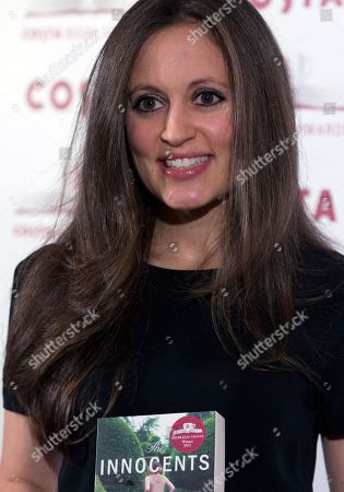 Author Francesca Segal winner of the Costa First Novel Award poses for photographers with the book 'Innocents' at the Costa Book awards in London