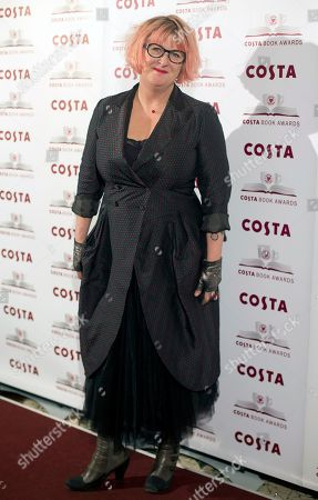 Author Sally Gardner winner of the Children's Book Award poses for photographers at the Costa Book awards in London
