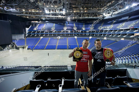 Boxers Denmark's Mikkel Kessler, left, and Britain's Carl Froch pose for photographers before a press conference at the 02 arena in London, . The super middleweight fighters are due to meet in the ring at the arena on May 25
