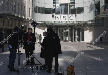 A television crew set up for alive transmission outside the BBC headquarters in London, Sunday, Nov, 11, 2012. The head of the BBC's governing body said Sunday the broadcaster needs a radical overhaul following the resignation of its chief executive in wake of a scandal over a botched report on child sex-abuse allegations. Chris Patten vowed to restore confidence and trust in the BBC, which is reeling from the resignation of George Entwistle and the scandals prompting his ouster. Entwistle resigned Saturday night amid a storm of controversy after a news program wrongly implicated a British politician in a child sex-abuse scandal, deepening a crisis sparked by revelations it decided not to air similar allegations against one of its own stars