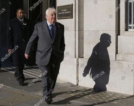 Chris Patten, Chairman of the BBC Trust walks out of the BBC headquarters to give a media interviews in London, . The head of the BBC's governing body said Sunday the broadcaster needs a radical overhaul following the resignation of its chief executive in wake of a scandal over a botched report on child sex-abuse allegations. Chris Patten vowed to restore confidence and trust in the BBC, which is reeling from the resignation of George Entwistle and the scandals prompting his ouster. Entwistle resigned Saturday night amid a storm of controversy after a news program wrongly implicated a British politician in a child sex-abuse scandal, deepening a crisis sparked by revelations it decided not to air similar allegations against one of its own stars