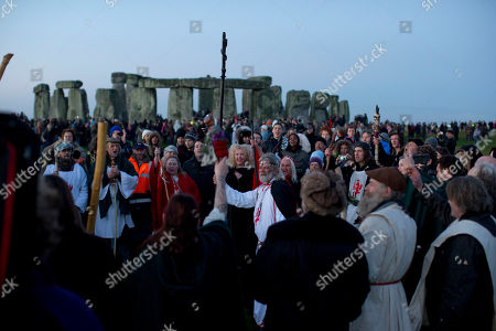 "Stock Photo of Druid leader Arthur Uther Pendragon, center, holds up his staff as he takes part in a ceremony before sunrise by the ancient stone circle of Stonehenge, in southern England, as access to the site is given to druids, New Age followers and members of the public on the annual Winter Solstice, . Doomsday hour is here and so still are we. According to legend, the ancient Mayans' long-count calendar ends at midnight Thursday, ushering in the end of the world. Didn't happen. ""This is not the end of the world. This is the beginning of the new world,"" Star Johnsen-Moser, an American seer, said at a gathering of hundreds of spiritualists at a convention center in the Yucatan city of Merida, an hour and a half from the Mayan ruins at Chichen Itza"