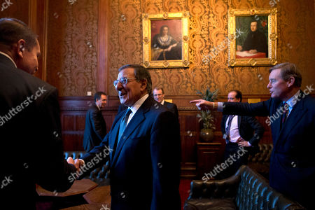 Leon Panetta, Andrew Robathan U.S. Defense Secretary Leon Panetta, center, joins members of Parliament for high tea, after a tour of the Houses of Parliament, led by Andrew Robathan, Minister of State for the Armed Forces of the United Kingdom, right, in London on