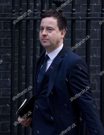 The editor of the Sun newspaper Dominic Mohan arrives for a meeting of fellow newspaper editors and the British Prime Minister David Cameron following the release of the Leveson media inquiry, at Downing Street in London,. Cameron has warned newspaper editors they must act quickly to set up an independent press regulator in the wake of a media ethics scandal