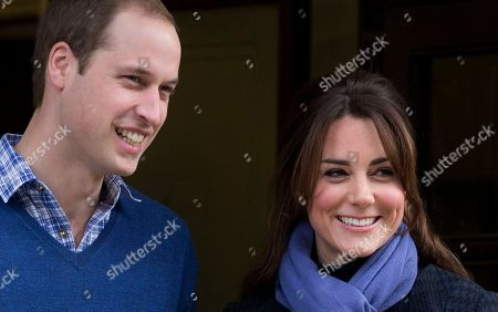 """Britain's Prince William stand next to his wife Kate, Duchess of Cambridge as she leaves the King Edward VII hospital in central London. Jurors at Britain's phone hacking trial have heard transcripts Thursday Dec. 19, 2013 of intercepted messages left by Prince William on Kate Middleton's phone, in which he calls her """"babykins"""" and jokes about almost being shot during a military training exercise. The messages from 2006 were found among the belongings of private investigator Glenn Mulcaire, who has been convicted of hacking the phones of aides to William and Prince Harry"""