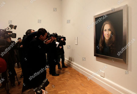 Members of the media photograph the newly-commissioned portrait of Kate, Duchess of Cambridge, by artist Paul Emsley on display at the National Portrait Gallery in London