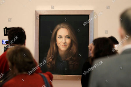 Stock Image of Paul Emsley Members of the media look at a newly-commissioned portrait of Kate, Duchess of Cambridge, by artist Paul Emsley on display at the National Portrait Gallery in London