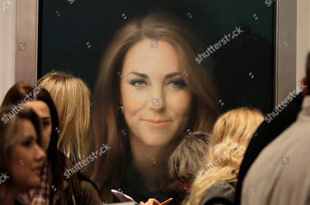 Members of the media gather in front of a newly-commissioned portrait of Kate, Duchess of Cambridge, by artist Paul Emsley on display at the National Portrait Gallery in London