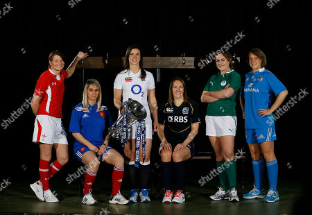 Women's team captains, from left, Rachel Taylor of Wales, Marie Alice Yahe of France, Sarah Hunter of England,t, Susie Brown of Scotland, Fiona Coughlan of Ireland, and Silvia Gaudino of Italy, pose with the trophy during a stage managed media opportunity at the launch of the 2013 Six Nations Rugby Union Championship in London