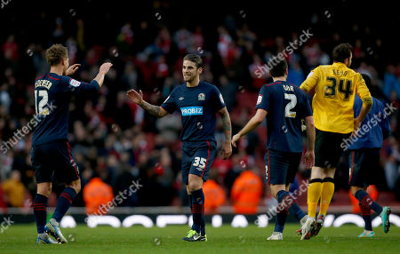 Blackburn Rovers players, from left, Morten Gamst Pedersen, David Bentley, Bradley Orr and goalkeeper Jake Kean celebrate winning 1-0 at the end of the English FA Cup fifth round soccer match between Arsenal and Blackburn Rovers at the Emirates stadium in London