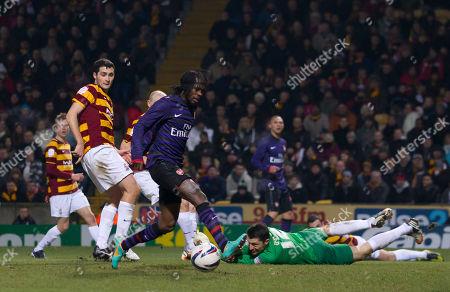 "Arsenal's Kouassi Gervais ""Gervinho"" Yao, centre left, fails to score past Bradford City's goal keeper Matt Duke during their English League Cup quarter final soccer match at Valley Parade Stadium, Bradford, England"