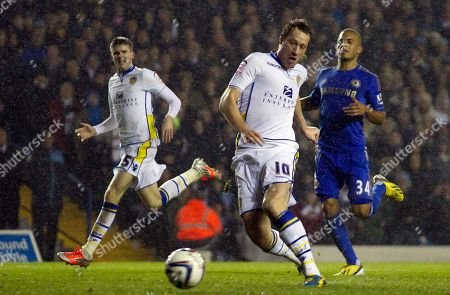 Leeds' Luciano Becchio, centre, scores against Chelsea, during their English League Cup soccer match at Elland Road Stadium, Leeds, England