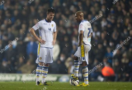 Leeds' El-Hadji Diouf, right, and Michael Tonge wait for play to restart after Chelsea's third goal during their English League Cup soccer match at Elland Road Stadium, Leeds, England