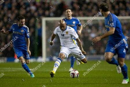 Leeds' El-Hadji Diouf, centre, keeps the ball from Chelsea's Juan Mata, left, during their English League Cup soccer match at Elland Road Stadium, Leeds, England