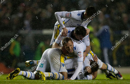 Leeds' Luciano Becchio, bottom centre, celebrates with jubilant teammates after scoring against Chelsea, during their English League Cup soccer match at Elland Road Stadium, Leeds, England