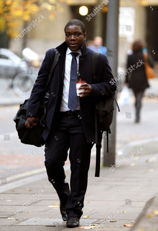 Kweku Adoboli arrives at Southwark Crown Court in London, . A former UBS trader accused of losing $2.3 billion in reckless deals is waiting for the verdict, after facing four charges of false accounting and two of fraud