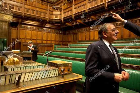 Stock Image of Leon Panetta, Andrew Robathan U.S. Defense Secretary Leon Panetta listens as Andrew Robathan, Minister of State for the Armed Forces of the United Kingdom, points in the House of Commons as Robathan leads Panetta on a tour of the Houses of Parliament in London on