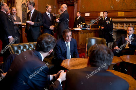 Stock Photo of Leon Panetta, Andrew Robathan U.S. Defense Secretary Leon Panetta, center, has high tea with members of Parliament after a tour of the building in London on . Panetta is in England as part of a weeklong swing across Europe. This is expected to be Panetta's last overseas trip as Pentagon chief, as he plans to step down after his replacement is confirmed