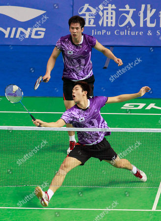 Stock Image of Ko Sung-hyun, Lee Yong-dae South Korea's Ko Sung-hyun, top, and Lee Yong-dae play against China's Cai Yun Cai and Fu Haifeng during their men's doubles quarterfinal match of the China Open World Superseries Premier badminton competition in Shanghai, China on . Ko and Lee won 21-17, 21-16