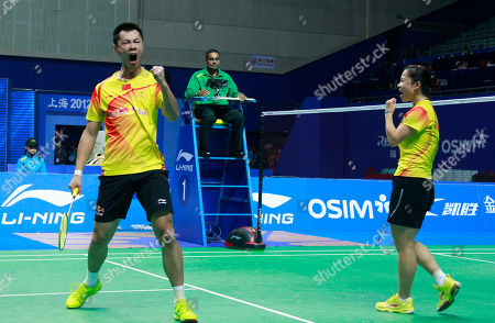 Xu Chen, Ma Jin China's Xu Chen, left, and Ma Jin, right, react after winning a point against Malaysia's Chan Peng Soon and Goh Liu Ying during their mixed doubles final match of the China Open World Superseries Premier badminton competition in Shanghai, China on