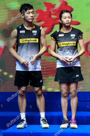 Malaysia's Chan Peng Soon, left, and Goh Liu Ying, right, hold their runner-up trophies during the awards ceremony for the mixed doubles of the China Open World Superseries Premier badminton competition in Shanghai, China on . China's Xu Chen and Ma Jin won the mixed doubles of the tournament