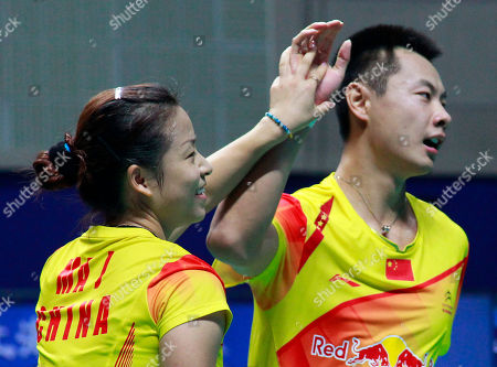 Xu Chen, Ma Jin China's Xu Chen, right, and Ma Jin, left, celebrate after defeating Malaysia's Chan Peng Soon and Goh Liu Ying during the mixed doubles final match of the China Open World Superseries Premier badminton competition in Shanghai, China on